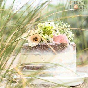 Bruidstaart Naked cake met verse bloemen